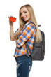 Smiling female student holding empty credit card