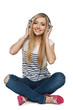 Female sitting on floor enjoying music in headphone