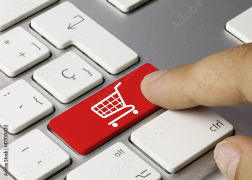Leinwandbild Motiv shop cart keyboard key. Finger