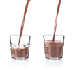 Filling glass of chocolate milkshake