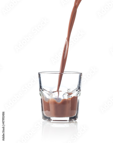 Filling glass of chocolate milkshake
