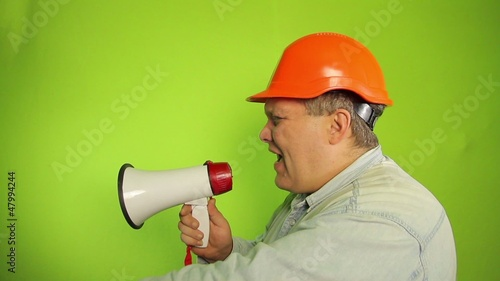 Foreman shouting into a megaphone on a green background