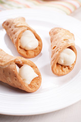 Italian cannoli pastry filled with cream