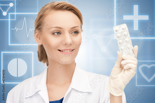 attractive female doctor with pills