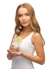 woman with lemon slice on glass of water