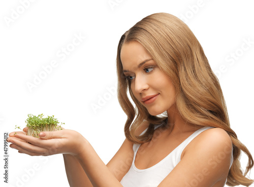 woman with green grass on palms