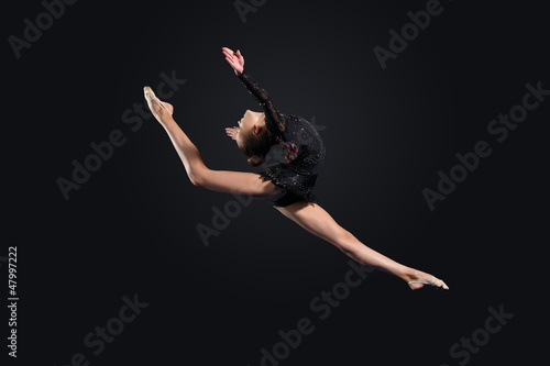 Fotobehang Dance School Young woman in gymnast suit posing