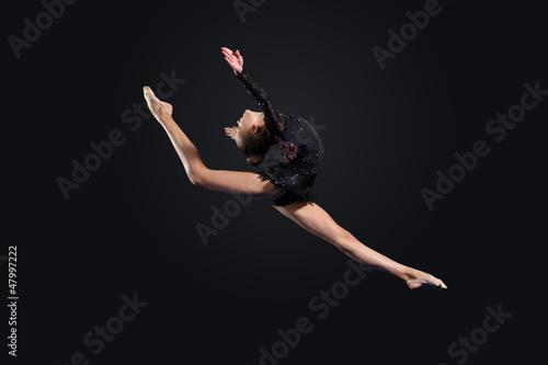 Plexiglas Dance School Young woman in gymnast suit posing