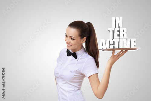 Waitress holding a tray with word interactive