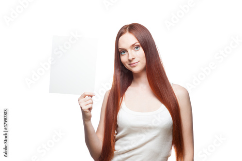beautiful red haired girl holding sign