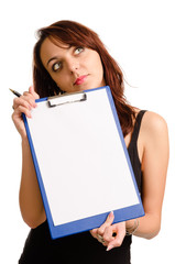 Thoughtful woman holding a blank clipboard