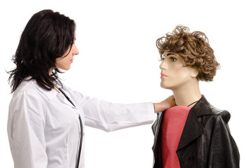 Woman doctor with a male mannequin