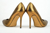Pair of golden colored High Heel