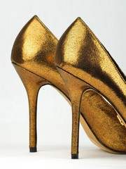 Pair of golden colored High Heels