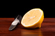 lemon fruit  and knife on wooden table black background