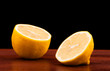 lemon fruit on wooden table black background