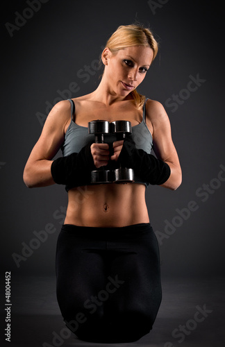 Fit woman holding weights