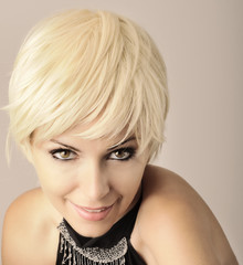 Young woman with short blond hair
