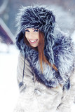 Fototapety Snow winter woman portrait outdoors on snowy white winter day.