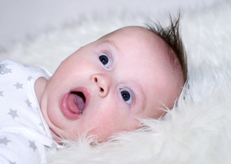 Portrait of the surprised three-months baby
