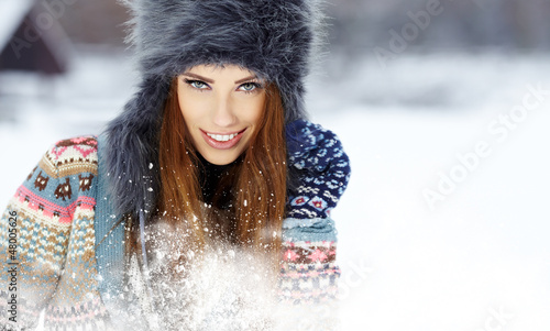 Snow winter woman portrait outdoors on snowy white winter day.