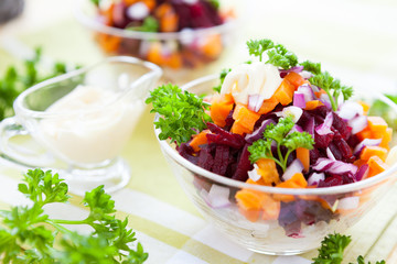 salad with baked vegetables and herring