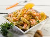 pasta with shrimp orange peel and almond, selective focus