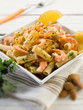 pasta with shrimp orange peel and almond, selective focus