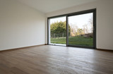 big empty room and a big window