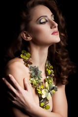 woman with makeup in luxury green necklace