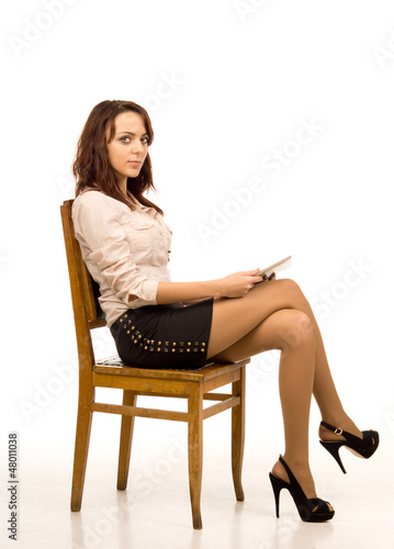 Attractive woman on wooden chair