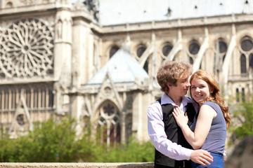 Hugging couple near Notre Dame de Paris