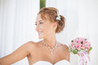 Portrait blond bride with wedding bouquet of roses