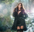 attractive young woman in a winter fashion shot  with snow flake