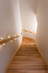 Wooden staircase decorated with lights