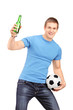 An euphoric fan holding a beer bottle and football cheering