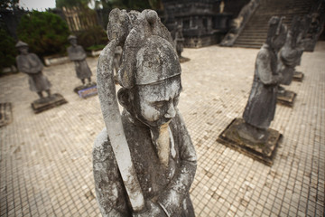 Warrior with sword statue guarding temple in Vietnam