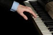 man hand playing piano