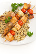 Salmon kebab with tomato, mushrooms and rice
