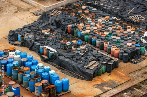 Chemical waste dump with a lot of barrels - 48023874