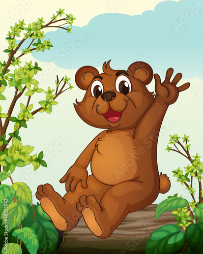 Foto op Aluminium Beren A bear sitting on a wood