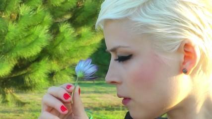 Woman Smells Flower