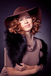 Red haired woma wearing elegant brown felt hat