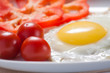 Fried eggs with tomatoes and pepper