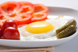 Fried eggs with tomatoes, cucumbers and pepper