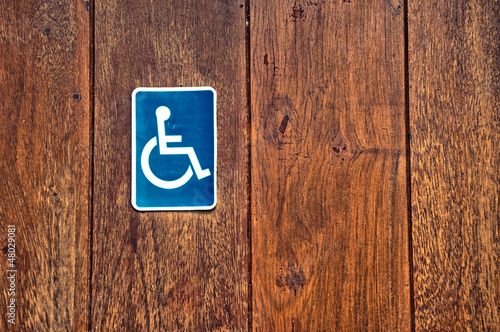 handicap sign on wooden background