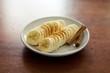 Banana a fette spolverata di cannella