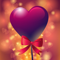 Red heart-shaped lollipop with ribbon