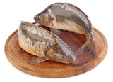fresh fish (carp) on wooden board
