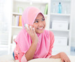 Southeast Asian teenager talking on phone